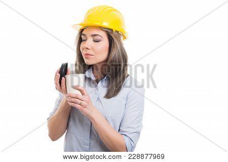 Pretty Female Constructor Enjoying Takeaway Coffee.