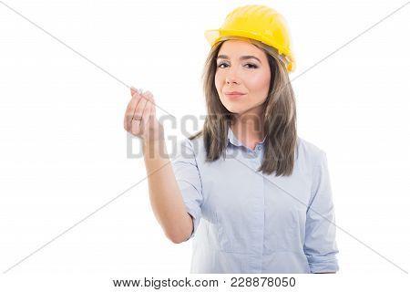 Portrait Of Female Constructor Showing Money Gesture.