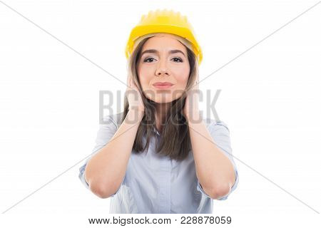 Portrait Of Female Constructor Covering Her Ears Like Not Hearing.