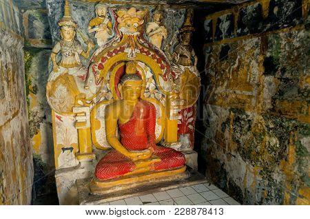 Kandy, Sri Lanka - Jan 5, 2018: Meditation Of Buddha Statue With Guards In Ancient Fresco Walls Of 1