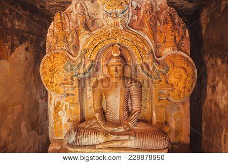 Kandy, Sri Lanka - Jan 5, 2018: Stone Figure Of Meditating Buddha Inside The 14th Century Buddhist T
