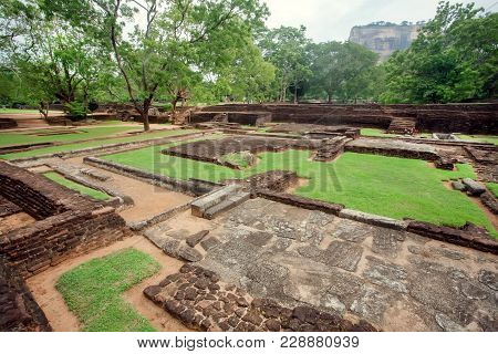 Ruins Of Ancient Town Under Sigiriya Rock, Sri Lanka. Park With Trees And Archeological Area. Unesco