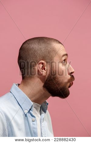 Young Casual Man Kissing. Emotional Man Kissing On Pink Studio Background. Male Profile. Human Emoti