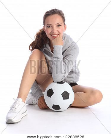 Happy Teenage Girl Football Player Sits With Ball