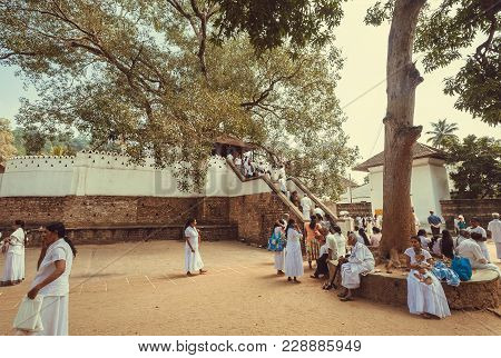 Kandy, Sri Lanka - Jan 5, 2018: Families Of Praying People Walking Near The Temple Of Sacred Tooth,