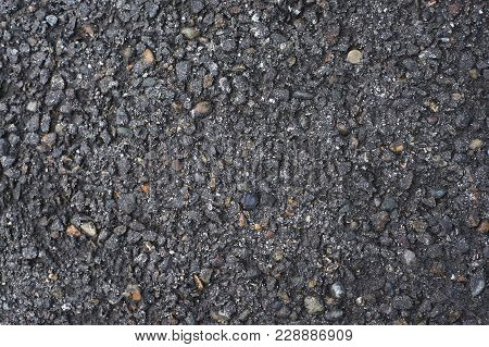 Uneven Black Surface. Dark Asphalt. Paved Road.