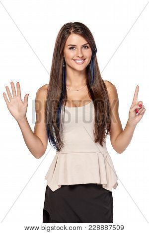Hand Counting - Six Fingers. Happy Woman Indicating The Number Six With Her Fingers