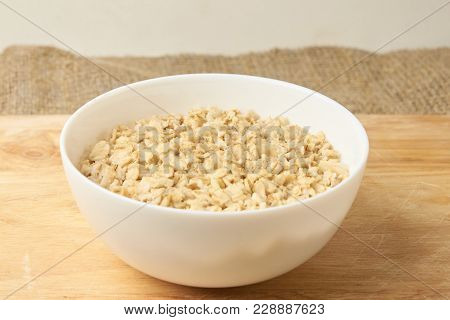 Oatmeal Porridge. Useful Breakfast. Neutral Background. White Cup.