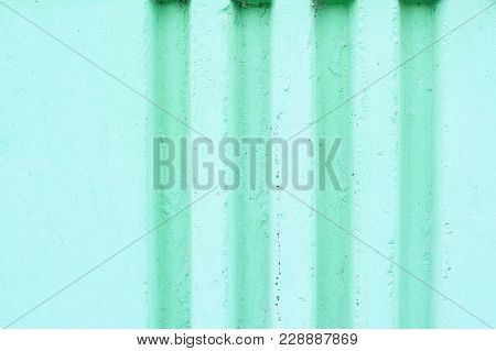 Vertical Grooves On The Wall. Beautiful Emerald Color.