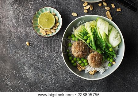 Meatballs, Rice, Bok Choy Bowl On A Gray Background With A Ceramic Dish. Flat Lay. Top View