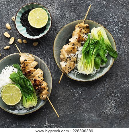 Teriyaki Chicken Skewers, Cabbage Bok Choy, Rice Buddha Bowl. Concept Of Healthy Eating. Top View