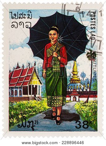 Moscow, Russia - February 28, 2018: A Stamp Printed In Laos, Shows A Woman In Traditional Laotian Dr