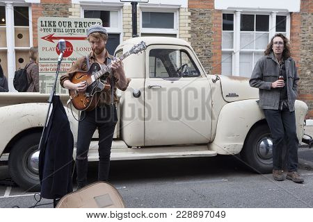 London, England - September 15, 2017 A Street Musician Performs At The Flower Market Columbia Road F