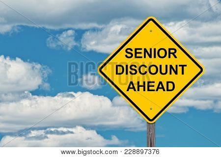 Caution Sign Blue Sky Background - Senior Discounts Ahead