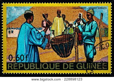 Moscow, Russia - February 28, 2018: A Stamp Printed In Guinea Shows Scene Of Traditional Native Life