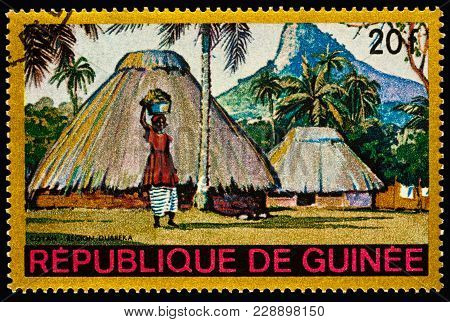 Moscow, Russia - February 28, 2018: A Stamp Printed In Guinea Shows Woman In African Village, Coyah,
