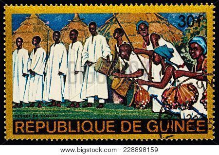 Moscow, Russia - February 28, 2018: A Stamp Printed In Guinea Shows Group Of Musicians With Traditio