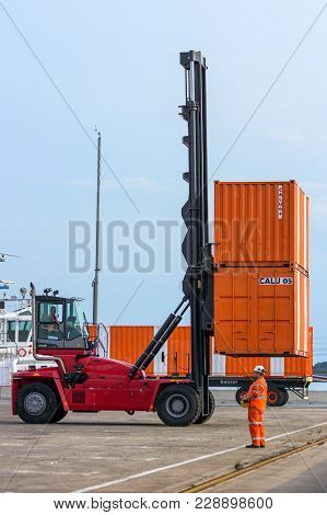 Rotterdam, Netherlands - Sep 8, 2013: Mobile Cargo Container Handler In Action At A Shipping Contain