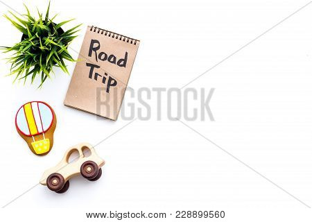 Family Trip Concept. Green Plant, Air Ballon Cookie, Car Toy. Road Trip Hand Lettering In Notebook O