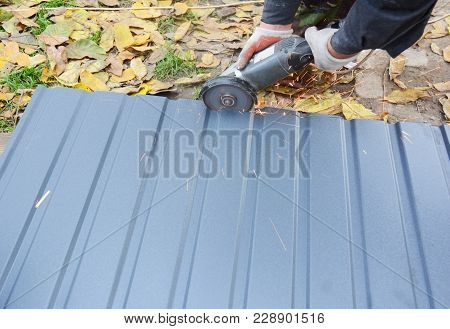 Roofer Cutting Metal Roof Sheets, Metal Tile  For House Roofing Construction. Cut Metal Tile Roof.