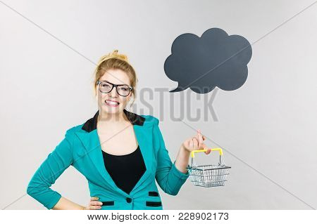 Happy Buying Things At Market Shops Concept. Business Woman Hand Holding Small Tiny Shopping Cart Tr