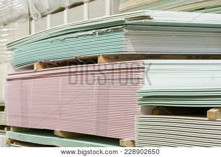 Warehouse With Plasterboard. Sheets Of Plasterboard On Pallets. Construction Materials. Drywall Ware