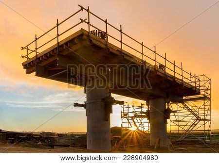 New Bridge Support Under Construction At Sunset.