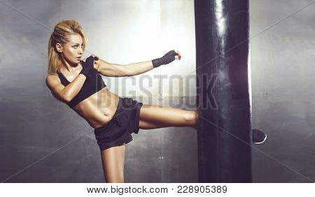 Fit And Sporty Young Woman Having A Muay Thai Training. Girl Training In Undergorund Gym. Health, Sp