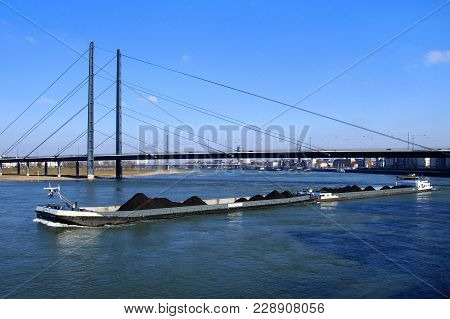 Düsseldorf, Germany - February 28, 2018: Dutch Combi Inland Waterway Motor Freighter Company On The