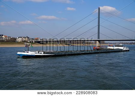 Düsseldorf, Germany - February 28, 2018: Dutch Inland Waterway Motor Freighter Lutin On The River Rh