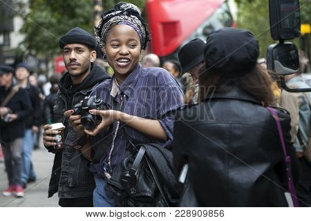 London, England - September 15, 2017 Photographer Blogger Makes His Way Through The Crowd During The