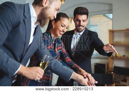 Young Business People Cheering With Hands Together