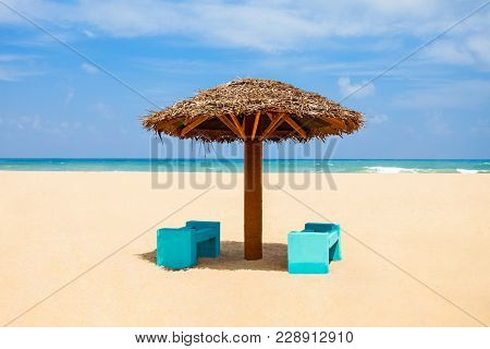 Deckchair Or Sunlounger With Umbrella On The Beauty Lonely Beach With Yellow Sand, Sri Lanka