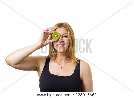 Young Cheerful European Woman With Blond Hair And Kiwi Eyes. Healthy Eating, Raw Food Concept