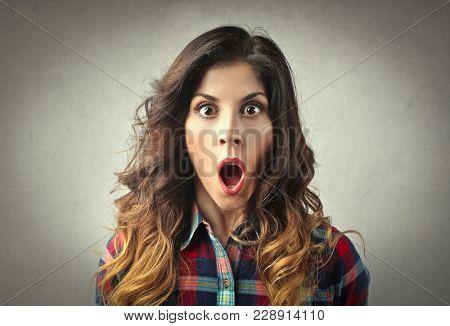 Portrait of shocked girl