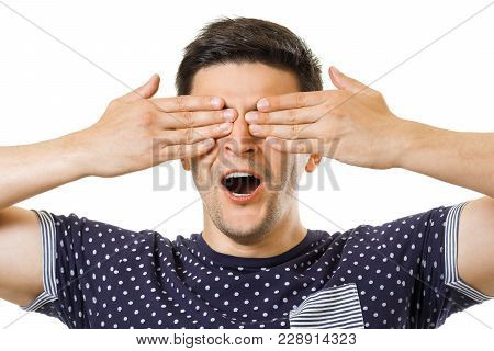 Young Brunet Hair Guy Cover His Eyes By Palms. Playing To Hide And Seek Game
