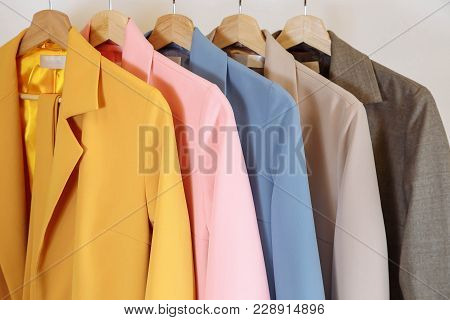 Collection Of Colorful Jackets On Hangers In Shop