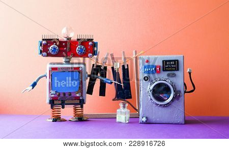 Robot Automation Laundry Room. Robotic Washer With Message Hello. Silver Washing Machine, Men's Jean