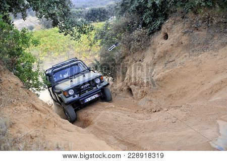 Cabrieres, France - October 14, 2017: A Toyota Land Cruiser Struggling To Climb A Steep Slope To Pas