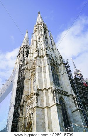 Twin Spires Of Church Know As Votivkirche Neo Gothic Church And Museum In Vienna, Austria.