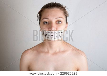 Woman With Taped Mouth With Inscription Word - Freedom.