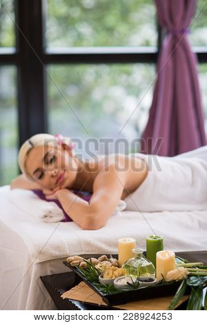 Pretty Blond-haired Woman Sleeping On Massage Table After Pleasant Spa Treatment, Interior Of Salon