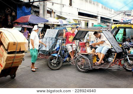 Manila, Philippines - February 3rd, 2013: Road Traffic In The Capital City With The Typical Motor-bi