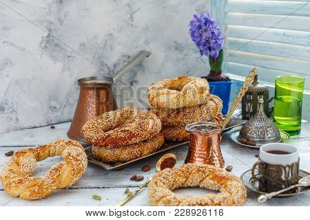 Tasty Bagels With Sesame Seeds And Pots Of Coffee.
