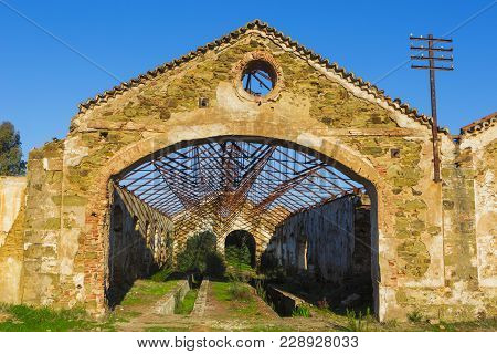 Ruins Of Abandoned Loading Bays For Trucks And Railway At Sao Domingos  Mine In Alentejo, Portugal