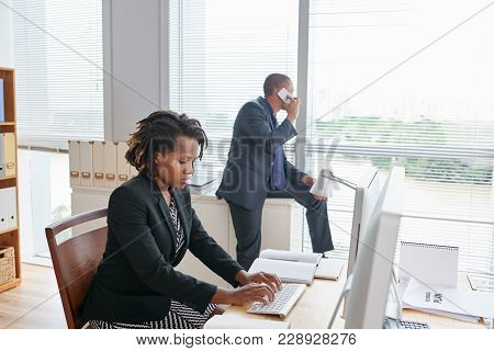 Busy Open Plan Office: Pretty Young White Collar Worker Sitting In Front Of Computer And Working On