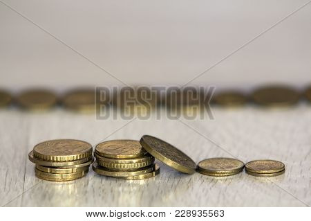 Coin Stack Or Money Stack And Row Of Coin On Wooden Table. Financial, Business Growth Concept. Inves