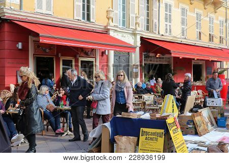 Nice, France - January 29, 2018; Antique Market In Nice With People Browsing Through Stalls Looking