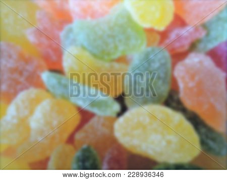 Blurred Shot Of Caramel Candy`s, Abstract Colored Background. Blurred Candy Background.motion Blur O