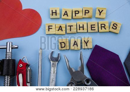 Happy Fathers Day Message On A Blue Background With Frame Of Tools And Ties. Celebration.